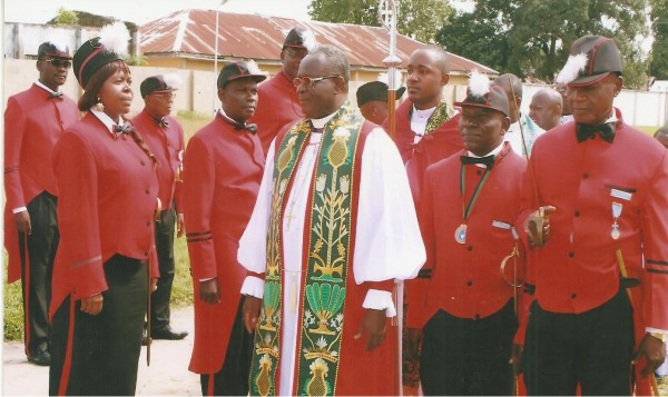 Ret. Rev. Chijioke Oti inspects a guard of honour mounted by the Knights during their Chapter meeting recently. Second from right is Sir Uche Osoagba, the President of the Council.
