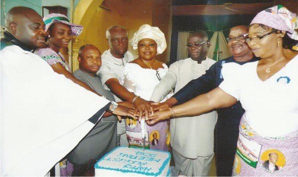 From Left: Ven Uchenna T. Ahams, JP his wife, Mrs. Chika Ahams JP, and other dignitaries cutting the August Meeting cake.