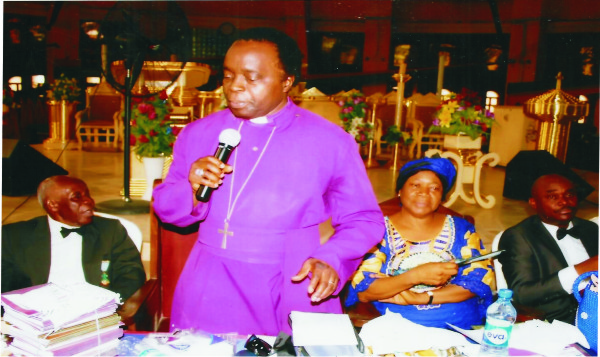 Bishop Okorocha making a speech after the presidential address by the Council's President, flanked by the left by the Chairman of the occasion, Hon Justice Duke Njiribeako (Rtd) and to the right by his wife, Dr (Mrs) Eunice Okorocha and Sir Ndukwe Nnawuchi, SAN (Registrar of the Diocese).