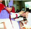 Archbishop B.C.I. Okoro installing Rev. Canon Uche Onwuzurike as a Canon of the Cathedral of SS Peter and John the Divine, Nkwerre