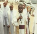 Rt Rev Cyril C. Okorocha PhD blesses Diocesan workers at the dedication ceremony.