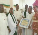 Sir Lewis Opara receives his award from the Vicar, Ven Chukwuma Akakuru and the Coordinator of the fathers in HTC, Sir Ngozi Ibe during the ceremony