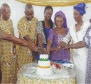 Christian Fathers cutting the cake with Vicar's wife and others at St. Stephen's Orji