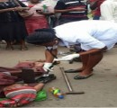 A pensioner  collapses during the protest