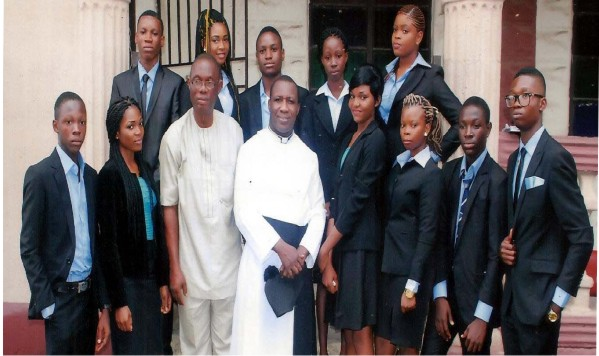 The Vicar of Christ's Church Owerri, Ven Zion Ngoka (Centre) and the principal  Christ the King Academy, Sir C.C. Obijaku, with the graduating students.