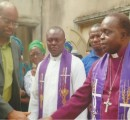 Bishop Okorocha (right) shaking hands with Mr. Iheanyichukwu Opurum while  the father  Sir Isaac Opurum (left) and Bishop Chaplain, Rev. Unaeze Ukaegbu and others watch.