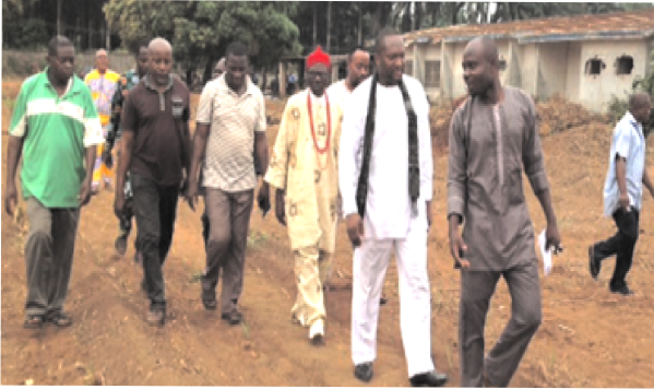 Project Committee Chairman on Ogbo Osisi Afor Oru relocation, Engr. Chika Ezeji, taking  Imo  commerce and industry commissioner, Chief Chidi Ibe, and the market leaders on  tour of the new market site at Old Ahiazu Mbaise General Hospital premises