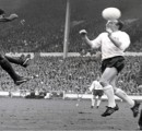 Nobby Stiles jumps up for the ball  during the  1966 Wold Cup semi-final