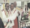 The Primate, Most Rev Nicholas Okoh apparently impressed by the beauty of the Cathedral and the achievements of Bishop Cyril C. Okorocha PhD  embraces him at the altar  during the dedication ceremony.  Watching is Barr. Ndukwe Nnawuchi, SAN, the Registrar of Owerri Anglican Diocese.