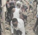 Villagers clearing the rubble to rescue trapped occupants.